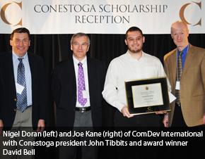 Nigel Doran and Joe Kane of ComDev International with Conestoga President John Tibbits and award winner David Bell